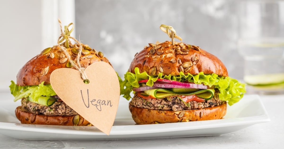 Vegan bean burgers with vegetables and tomato sauce on
